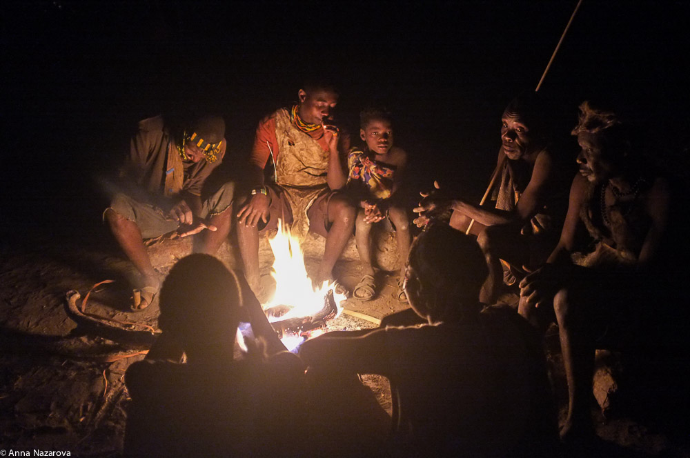 hadza people sitting around fire at Lake Eyasi