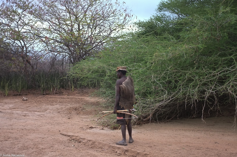 Hadza hunter at lake Eyasi during hunting