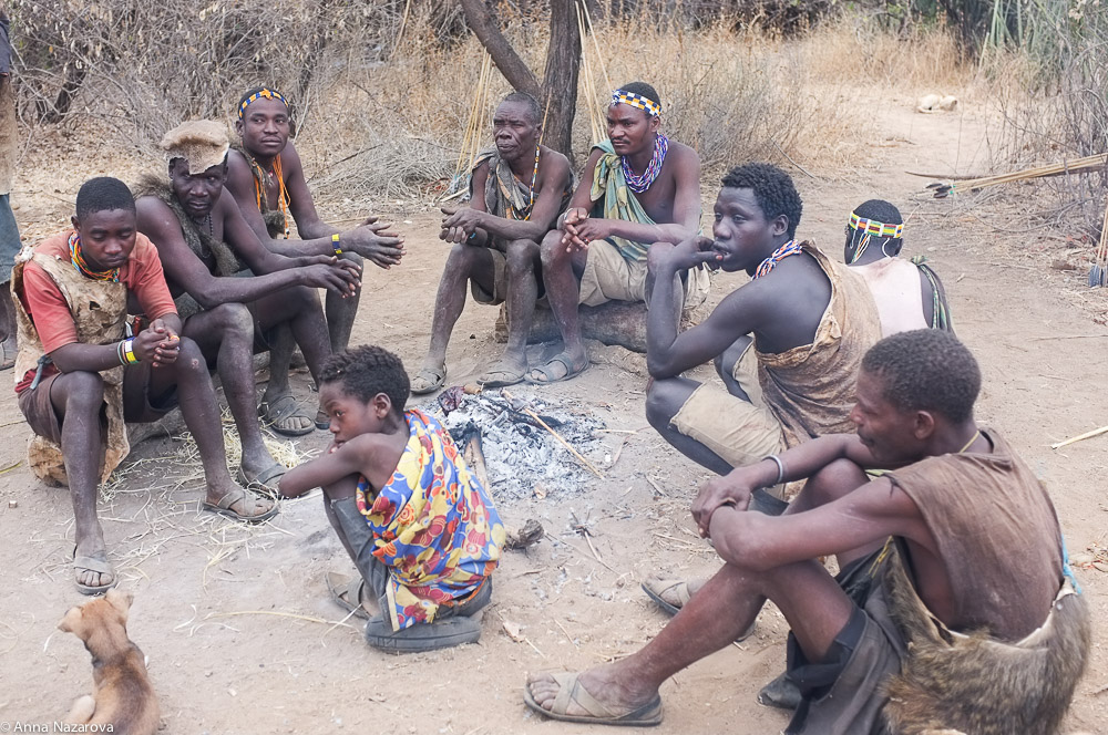 Hadza men at fire place