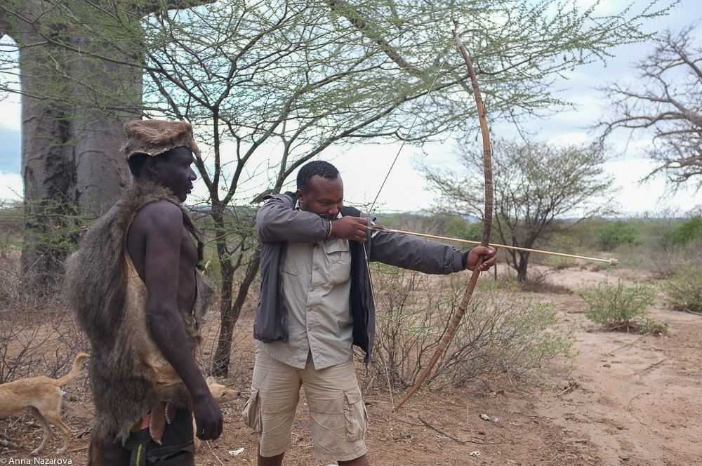 shooting a bow with hadza people at lake  Eyasi