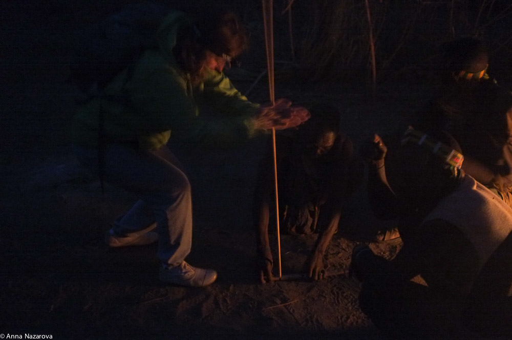 trying to get some fire with hadza people at the fireplace at Lake Eyasi
